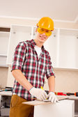 Repairman making markup — Stock Photo