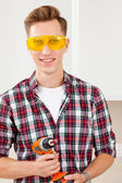 Smiling repairman with a dril — Stock Photo