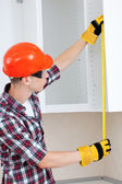 Builder with yellow tape measure — Stock Photo