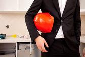Businessman holding red helmet — Zdjęcie stockowe