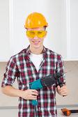 Operaio con perforatore — Foto Stock