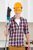 Worker with perforator — Stock Photo