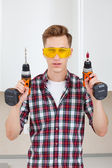 Master with screwdriver and drill  — Stock Photo