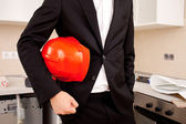 Businessman holding red helmet — Stock Photo