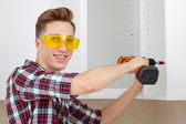 Master with screwdriver — Stock Photo