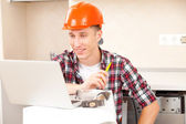 Workers with a laptop — Stock Photo