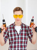 repairman with a drill and a screwdriver — Stock Photo