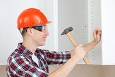 Repairman with hammer — Stock Photo
