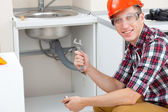 Plumber with pipe wrench — Stock Photo