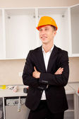 Smiling engineer in the interior — Stock Photo