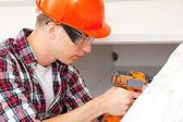 Repairman with electric drill  — Stock Photo