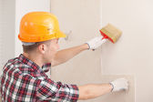 Worker with paint brush — Stock Photo