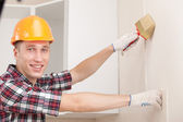 Young worker with paint brush — Stock Photo