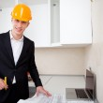 Engineer with blueprints — Stock Photo