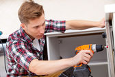 Repairman screwdriver works — Stock Photo
