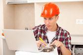 Engineer calculates estimates for repair — Stock Photo