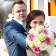 Bride and groom with bouquet — Stock Photo #51072195
