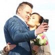 Beautiful bride and groom make selfie — Stock Photo #51211341