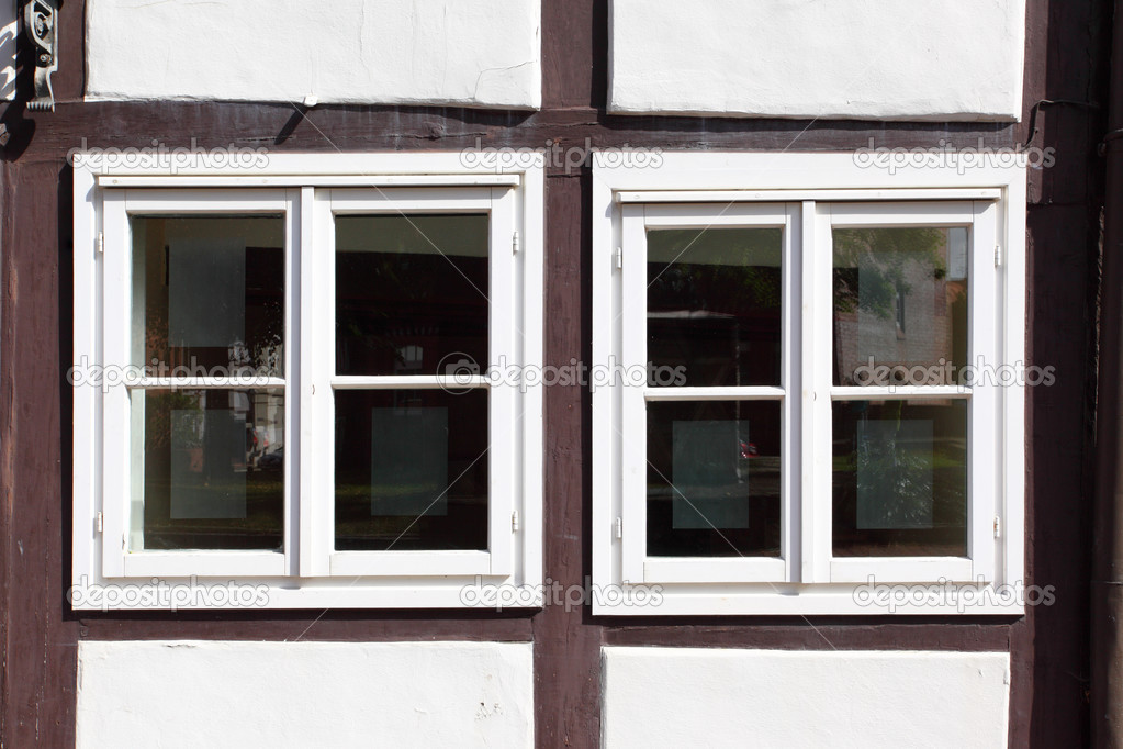 Windows of old timber framing house  Stock Photo #12494467