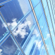 Stock Photo: Office building and sky reflection
