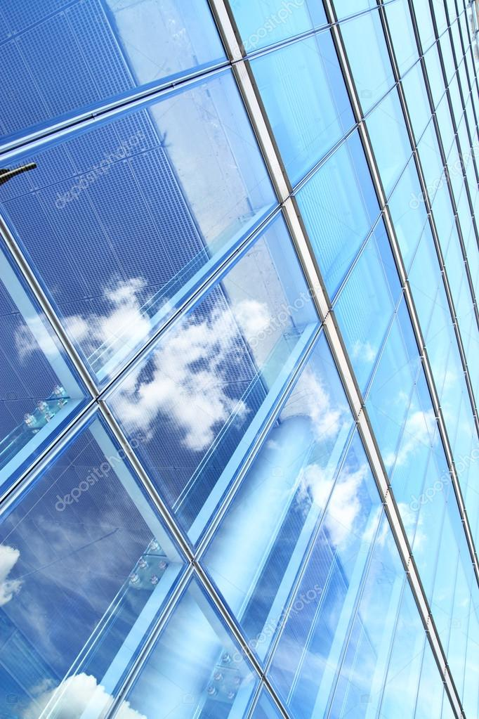 Glass wall of office building and sky reflection, may be used as background  — Stock Photo #12747330