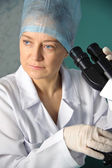 Portrait of a female doctor with a microscope. — Stock Photo