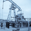 ストック写真: Pump jack and oilwell.