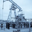 Stockfoto: Pump jack and oilwell.