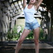 Pretty girl in shorts. - Stock Photo