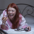 Woman in hysterical depression watch tv with vine — Stock Photo #20751445