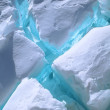 Blue cracks in ice - Stock Photo