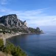 Mountain on sea coast - Stock Photo