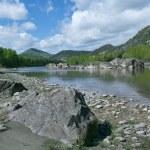 Mountain river under blue sky — Stock Photo #27113243