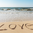 Beach with sand word love — Stockfoto