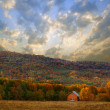 House in autumn forest in mountain — Stock Photo