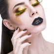 Beauty woman with long yellow lashes and black lips — Stock Photo