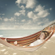 Child relaxing in a hammock — Stock Photo #35609887