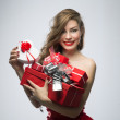 Girl in red dress with gifts on Valentines Day — Stock Photo #39570061