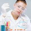 Stock Photo: Womwith test tubes in chemistry