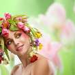 Beauty woman portrait with wreath from flowers — Stock Photo #41217491