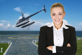 Business woman and helicopter — Stock Photo