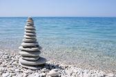 Spa stone on sea coast — Stockfoto