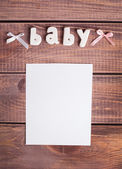 Word baby and white frame photo — Stock Photo