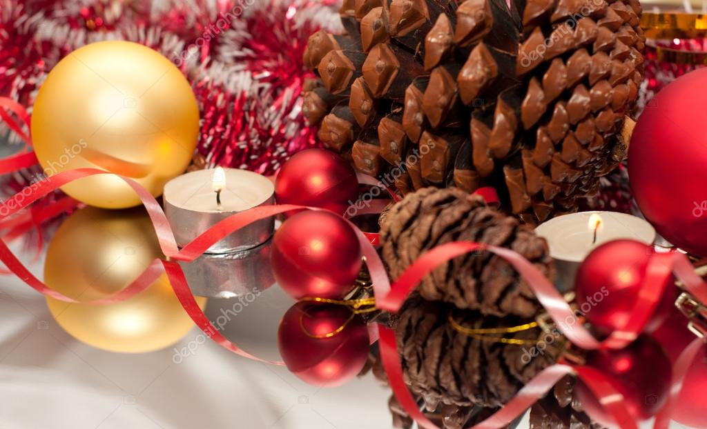 Christmas Bauble, candles and ribbon — Stock Photo #13776596