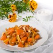 Baked pumpkin and marigold on a table — Stock Photo