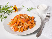 Baked pumpkin on white plate — Stock Photo