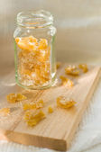 Candied ginger in glass — Stock Photo