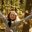 Happy woman in autumn park — Stock Photo #31981257