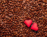 Two red hearts on coffee beans — Stock Photo