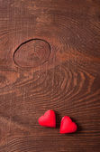 Two red hearts on wooden background — Stock Photo